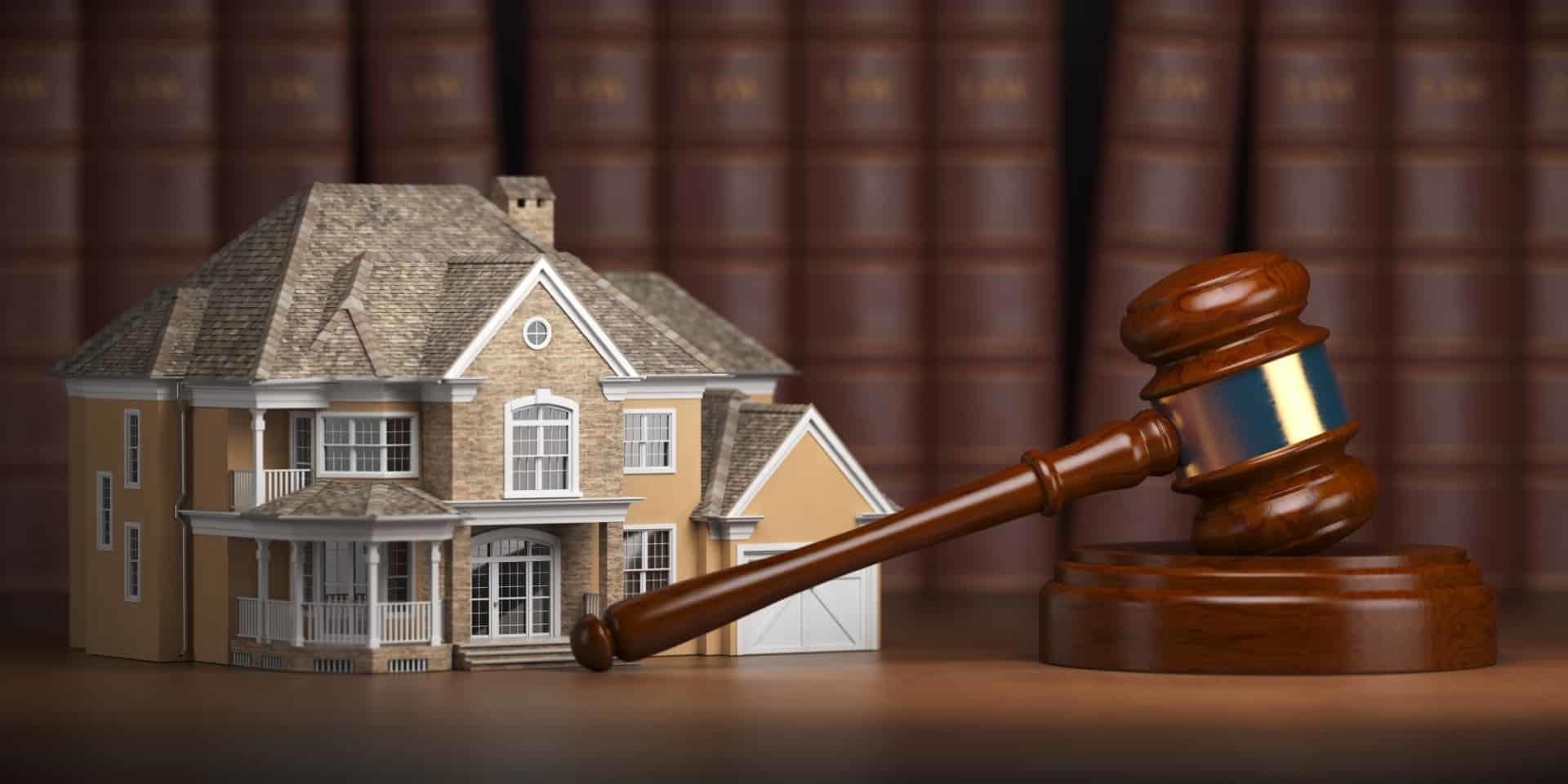 house-with-gavel-and-law-books-real-estate-law-XM3QZCA-Large