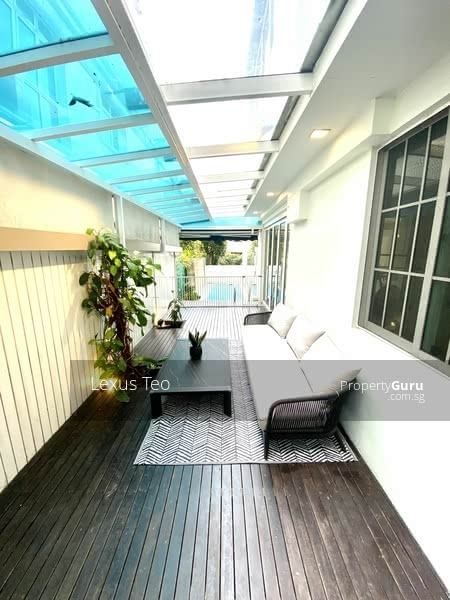 Sheltered lifestyle relaxation area facing swimming pool